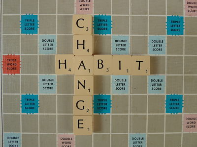 Habit and change spelled with Scrabble